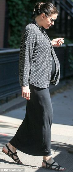 Monochrome maternity: The 39-year-old donned a black maxi dress which hugged her burgeoning belly. The actress layered a breezy polka dotted blouse over her casual frock, and teamed the relaxed look with strappy sandals