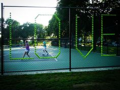 Someone had a lot of time on their hands to put every single tennis ball on the fence. Awesome though