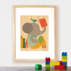 Petit Collage Reading Elephant print on wood - love these prints on wood, maybe good for a reading nook :)