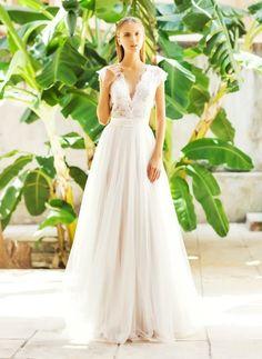 Lekkość, zwiewność i efektowność-  to cechy charakteryzujące suknie ślubne z wykorzystaniem tiulu.