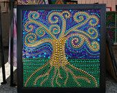 Amazing artwork from fully recycled materials! Mardi Gras beads!