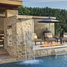 The raised deck presents another sitting area behind a  fire pit. Waterfalls spill over walls clad in Kansas Rubble limestone. #phgmag #pools #Landscape