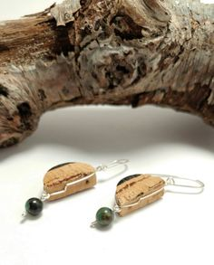 One of a kind Turquoise beaded recycled wine cork earrings!  Ever wonder what to get that friend that has everything?! Well these cork earrings are your perfect solution....especially if she LOVES wine!  <Details> ~Delicately wire wrapped with natural Turquoise bead accents ~Recycled wine cork was hand cut and sanded to desired thickness and texture ~Hand burnt design was lightly laquered for preservation with a touch of shine ~Nickle free wire for my sensitive friends ~Handmade in Mich...