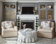 Living Room by Reusch Interior Design, Ottoman, Gray, Blue, Rug, fireplace, mantle, built-ins