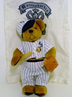 "Knickerbocker Baseball Bear Alexander. He is also a musical bear. Located above his right hip is a turn key for music box, that plays ""Take Me Out to the Ballgame""."