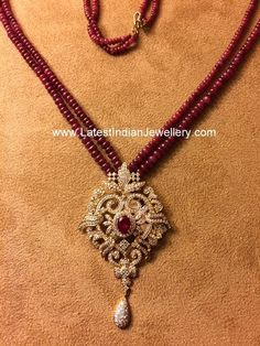 Small ruby beads chains intricate medium size necklace with designer diamond pendant. Studded with ruby stone in the center. Hanging with. Beaded Jewelry Designs, Gold Earrings Designs, Necklace Designs, Gold Bangles Design, Gold Jewellery Design, Designer Jewellery, Jewellery Shops, Vintage Jewellery, Jewellery Box
