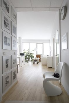Love the framed wall    Photography: White apartment in Vilnius by Lina Gavėnaitė, via Behance