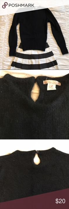 Sweet puff sleeve super warm angora sweater From Urban Outfitters. Very warm angora to keep you warm this winter. Perfect piece to wear with fun skirt and leggings and boogies. Very nice rhinestone button in back. Good used condition.  Size says medium but I am a small and this always fit me well so I think it runs small. Urban Outfitters Sweaters Crew & Scoop Necks