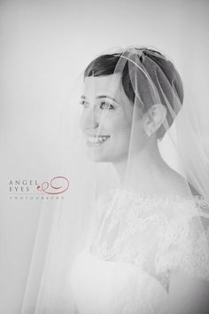 Pixie cut brides have more options than a birdcage veil. I wore a drop veil, secured by wig clips. Gave it more of a Grace Kelly look. Photo credit: Angel Eyes Photography