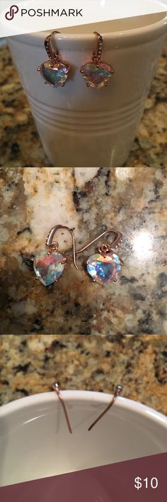 Juicy Couture iridescent heart rose gold earrings Juicy Couture iridescent heart rhinestone rose gold earrings. Rainbow sparkle! Earring backs are not available. Good condition!! They sparkle so beautifully in the light! Juicy Couture Jewelry Earrings