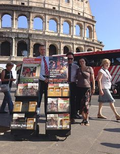 Rome, Italy - Public witnessing right in front of the same Coliseum where the early (true) Christians were brutally murdered for their unwavering faith and dedication to God! #literature_cart