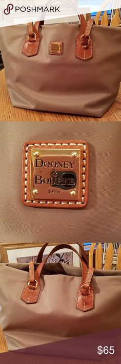 DOONEY & BOURKE SHOPPING TOTE MEDIUM!!! Medium sized, light weight, nylon shopper. Two set of handles, inside is red and black and immaculate! This a khaki/taupe colored bag, goes with everything for spring summer!!!! Gold hardware, key attachment, tan leather handles. Comment me for measurements and questions if needed. Excellent used condition. NO TRADES, reasonable offers!TY Dooney & Bourke Bags Totes