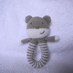 Thank you so much for your interest in my little teddy rattle. Here, at last, is the pattern. As usual, please do not sell this patte. Babyrassel [Free Pattern] This Easy To Make Baby Rattle Is So Adorable! - Knit And Crochet Daily Crochet Teddy Bear Pattern, Crochet Baby Toys, Crochet Diy, Crochet Amigurumi, Crochet For Kids, Amigurumi Patterns, Crochet Dolls, Baby Knitting, Crochet Patterns