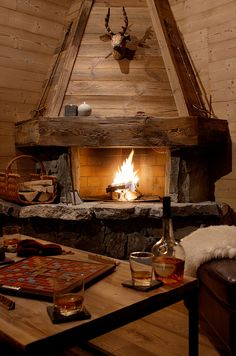 The cosy living area in Chalet Joran has a huge open fire to relax in front of!