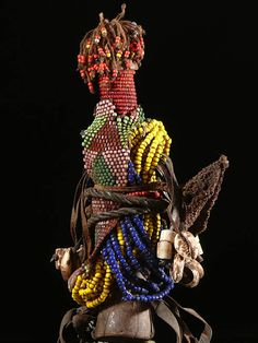Fertility Doll ~ Ham Pilu ~ from the Fali people of Cameroon. Wood, leather, glass beads, cotton, ca. 1990