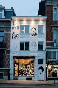 Librairie Ptyx, Brussels-interesting drawings on the facade of different authors