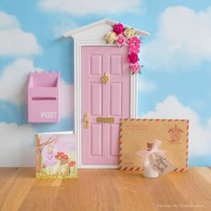 Adorable pretty pink Fairy Door with a hand painted birdhouse and tiny roses. Includes a personalised letter from the Fairies and tiny Fairy Key, gift boxed