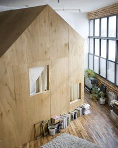 The free-standing bedroom structure features a pitched roof, echoing the elemental cabin form.
