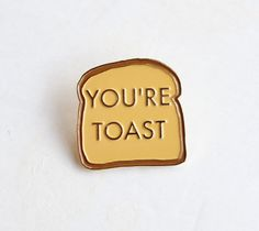"You're Toast Funny Lapel Pin - 1.25"" soft enamel, gold metal finish sold by The Silver Spider Print Shop. Shop more products from The Silver Spider Print Shop on Storenvy, the home of independent small businesses all over the world."