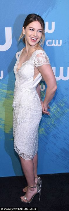 Pretty look: The 27-year-old beauty wore a delicate, lace dress with a V-neck front
