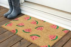 Grab a stencil and spray paint to DIY this door mat.