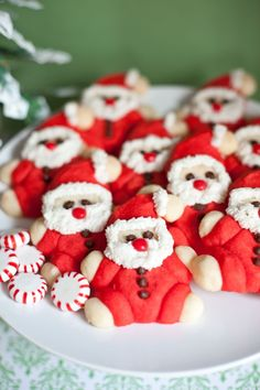 Santa Cookies -  Ingredients for Santas 1 cup butter  1/2 cup sugar 1 tablespoon milk 1 teaspoon vanilla  2 1/4 cups flour  red food coloring  mini chocolate chips (for eyes and buttons)  Red Hots for nose   Ingredients for frosting: 1/2 cup shortening  1/2 teaspoon vanilla 1 1/3 cup powdered sugar  1 tablespoon milk