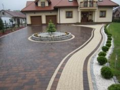 A statement driveway as a continuation of the fabulous home style. this can be created with Holland pavers in (Red / Charcoal) using tan as the designated walkway. Front House Landscaping, Front Garden Landscape, Driveway Landscaping, Landscape Design, Front Driveway Ideas, Driveway Design, Backyard Retreat, Backyard Patio, Stained Concrete Driveway