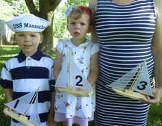 """Nautical Baby Announcement Photo/Announcing #3.  We used these cute boats for our wedding reception table numbers and I got to put them to good use again!  NOW HEAR THIS! The kids have an announcement: Welcome aboard Baby """"B"""" #3! He/She is due in October!"""