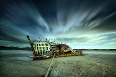 "Beached and broken, by trevcole "" An old wreck left abandoned off the west coast of Donegal, Ireland - Cara na Mara or 'Bad Eddies' boat. A skeleotn of its formwe self """