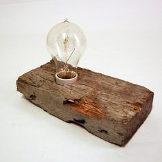 A delicious mix of shape and texture, this old weathered 2x4 lamp adds conversation to an otherwise boring side table, nightstand or shelf.    Our lovingly recycled lamp features a classic 40W Edison style filament bulb, in-line ON/OFF switch and a 6ft cord for those hard to reach outlets.    The warm glow of the 40W Edison bulb creates the perfect atmosphere and the filaments are lovely to look at either on or off.    *LAMP WILL SHIP 3-5 DAYS AFTER RECEIPT OF PAYMENT*
