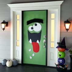 Dress up your home for Halloween with these DIY Halloween door decorations. We've got tons of front door Halloween decoration ideas to make your house the most festive on the block. Spooky Halloween, Deco Porte Halloween, Halloween Veranda, Halloween Front Doors, Halloween Crafts, Halloween Monster Doors, Halloween Party, Halloween Supplies, Halloween Poster