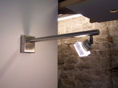 LED exterior layered glass wall light.  Available in natural tint green or white glass (white glass illustrated)