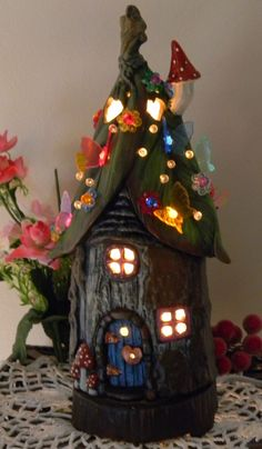 Gnome House Tree stump Leaf Roof Tree Stump House - A Fairy Dream Home- Night light Lamp butterfly and daisy lights - Mail box included. $55.00, via Etsy.