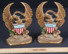 THESE PAIR OF BOOKENDS DONE IN METAL, ARE MARKED PLURIBUS UNUM IS LATIN FOR OUT OF MANY, ONE. IS A PHRASE ON THE SEAL OF THE UNITED STATES. MEASURES 7 IN TALL.
