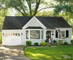 A lightened-up exterior brings this small cottage into modern times without sacrificing character. A simple color scheme of gray and white with black accents makes the home appear larger, and custom touches like a new front door and window box boost appeal./