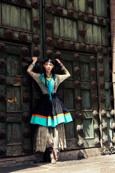 it's cool how her clothes blend with the door // Han Hye Jin / Vogue Korea July / shot by Alexander Neumann