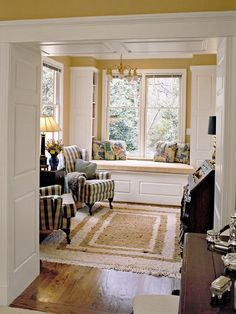 window seat. With bookshelves facing in.  Love the detail on the faces of the bookshelves.