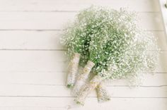 tara mcmullen photography  simple bridesmaids bouquets by tiffany pratt.  baby's breath sprayed with glitter, wrapped in twine with gold and silver safety pins.  DIY bridesmaids bouquets