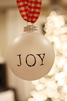 """stampedthe word """"JOY"""" and sprinkled a little black embossing powder on the letter before heating away"""