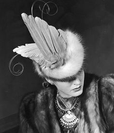 Model is wearing a sable fur coat with fur and feathered hat by John Frederics, photo by Alfred Eisenstaedt, 1939