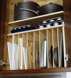 Great way to organize cutting boards, cake pans, muffin tins, cookie sheets, etc.