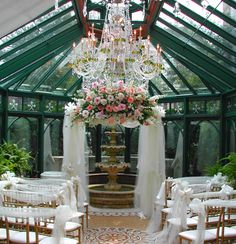 ceremony  arch with tulle and flowers