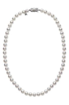 Mikimoto pearls   grade A1 Akoya pears and 18k white gold.  A beautiful classic piece, always in style, and thus, a good investment.
