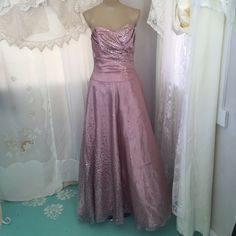 Beautiful Pink Prom Dress with gold & purple dots Beautiful champagne colored strapless prom dress with gold and purple sparkly polka dots on parts of the dress. It is princess cut with a fitted bodice and the skirt flares out a bit. Brand is Masquerade and the size is 5/6. Worn twice. Nothing wrong with it. Masquerade Dresses Prom