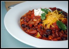 vegetarian black bean chili. This is my new favorite chili, loved it.  Even Sam ate an entire bowl for dinner.  I only used regular chili powder, and I let it simmer for about 3 hours. Made again with recommended spices...fine the first day but way too spicy the next day, especially for kids.