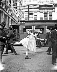 A Mardi Gras street performer, Canal Street, New Orleans, c. 1920.