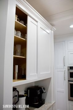 Sliding Cabinet Doors with Inset Track and Glides - Sawdust Girl® Diy Cabinets, Kitchen Cabinets Sliding Doors, Kitchen Cabinets, Diy Home Bar, Cabinet Door Hardware, Diy Sliding Door, Sliding Cabinet Doors, Sliding Cupboard, Sliding Cabinet Door Hardware