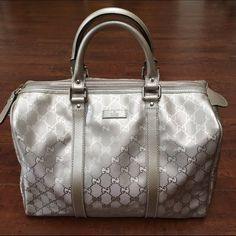 Silver Gucci Joy Boston Bag Silver Gucci metallic Joy Boston bag with cute charm and original protective sleeve. Good, clean, like new condition. Gucci Bags Satchels