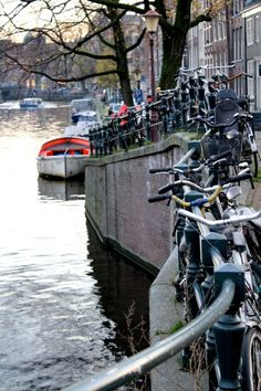 Boat + Bike = Amsterdam I'm thinking, I would love to live her and live the life style.