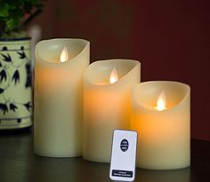 Remote Included 3 Pieces Set Moving Flame Wick Candle with Timer, Real Wax Pillar Candle in 3 Sizes, NOT Luminara but same flame effect GooDeal http://www.amazon.com/dp/B015SR7M0K/ref=cm_sw_r_pi_dp_2RrPwb1HWAMQK